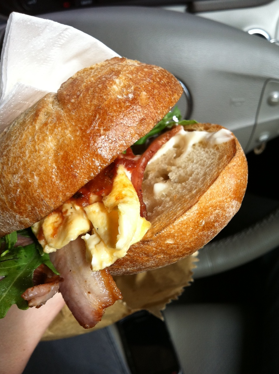 Bacon and egg roll with aioli, rocket and spicy tomato relish ...